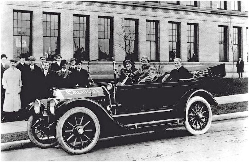 A 1912 Chevrolet Classic Six, with Louis Chevrolet in the white coat. PHOTO: GENERAL MOTORS